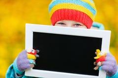Little girl outdoors on autumn day Stock Photos