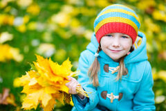 Little girl outdoors on autumn day Royalty Free Stock Image
