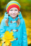 Little girl outdoors on autumn day Stock Image