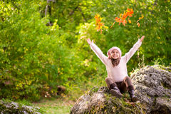 Little girl outdoors at beautiful autumn day Royalty Free Stock Photography
