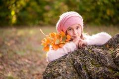 Little girl outdoors at beautiful autumn day Stock Photo