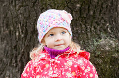 Little girl outdoors by fall Royalty Free Stock Photos