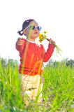 Little girl outdoors with flowers Stock Photos