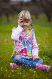 Little girl outdoors with imaginary binoculars Stock Photo