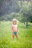 Little girl outdoors in rain Royalty Free Stock Images