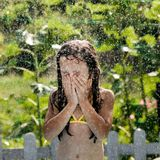 Little girl outdoors in rain Royalty Free Stock Photography