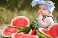 Little girl outdoors with red watermelon Stock Image