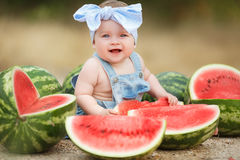 Little girl outdoors with red watermelon Royalty Free Stock Image