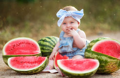 Little girl outdoors with red watermelon Royalty Free Stock Photos