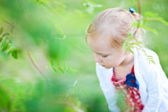 Little girl outdoors at summer day Stock Photo
