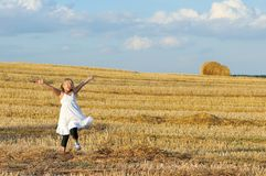 Little girl outdoors in sunny summer day Royalty Free Stock Photo