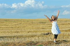 Little girl outdoors in sunny summer day Stock Photos