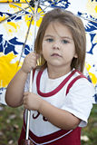 Little girl outdoors with umbrella Stock Photo