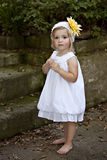 Little Girl Outdoors in Whtie dress Royalty Free Stock Image
