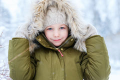 Little girl outdoors on winter Royalty Free Stock Photos