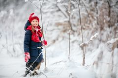 Little girl outdoors on winter. Adorable little girl wearing warm clothes outdoors on beautiful winter snow day Royalty Free Stock Images