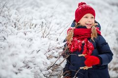 Little girl outdoors on winter. Adorable little girl wearing warm clothes outdoors on beautiful winter snow day Stock Photography