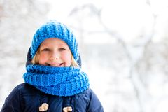 Little girl outdoors on winter. Adorable little girl wearing warm clothes outdoors on beautiful winter snowy day stock photos