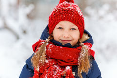 Little girl outdoors on winter. Adorable little girl wearing warm clothes outdoors on beautiful winter snowy day Royalty Free Stock Photos