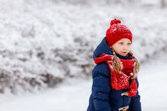 Little girl outdoors on winter. Adorable little girl wearing warm clothes outdoors on beautiful winter snowy day Stock Image