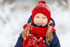 Little girl outdoors on winter. Adorable little girl wearing warm clothes outdoors on beautiful winter snowy day Stock Photography