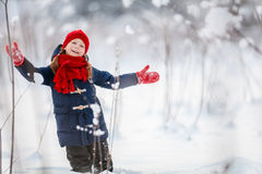 Little girl outdoors on winter. Adorable little girl wearing warm clothes outdoors on beautiful winter snowy day Royalty Free Stock Images