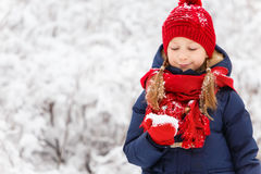 Little girl outdoors on winter. Adorable little girl wearing warm clothes outdoors on beautiful winter snowy day Royalty Free Stock Image