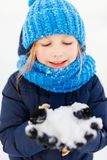 Little girl outdoors on winter. Adorable little girl wearing warm clothes outdoors on beautiful winter snowy day Royalty Free Stock Photo