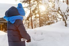 Little girl outdoors on winter. Adorable little girl wearing warm clothes outdoors on beautiful winter snowy day Royalty Free Stock Photography