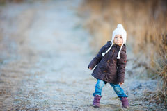 Little girl outdoors on winter day Royalty Free Stock Photo
