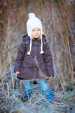 Little girl outdoors on winter day Stock Image