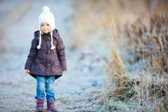 Little girl outdoors on winter day Royalty Free Stock Image