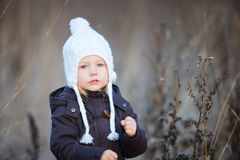 Little girl outdoors on winter day Stock Photo
