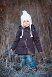 Little girl outdoors on winter day Stock Images