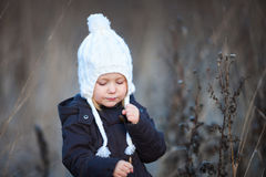 Little girl outdoors on winter day Royalty Free Stock Photography