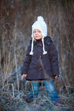 Little girl outdoors on winter day. Portrait of adorable little girl wearing parka outdoors on cold winter day stock images