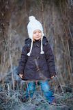 Little girl outdoors on winter day. Portrait of adorable little girl wearing parka outdoors on cold winter day royalty free stock photos
