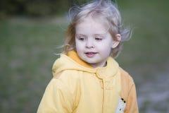 Little girl outside. Litlle girl outside. Vertical shot Royalty Free Stock Image