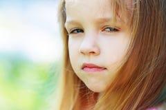Little girl outside Stock Images