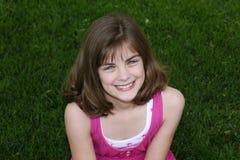 Little girl outside in grass. Very pretty little girl outside in grass Stock Photography