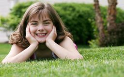 Little girl outside in grass Stock Photography