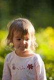 Little girl outside in spring Stock Photos