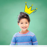 Little girl over chalk board background at school Royalty Free Stock Photos