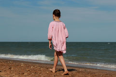 Little girl over the sea beach Royalty Free Stock Photo