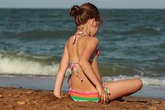 Little girl over the sea beach. Little girl enjoy sunshine, sea and summertime Royalty Free Stock Photo