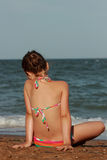 Little girl over the sea beach. Little girl enjoy sunshine, sea and summertime Stock Photo