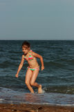 Little girl over the sea beach Royalty Free Stock Photos