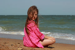 Little girl over the sea Stock Photography