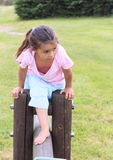 Little girl overcoming barrier Royalty Free Stock Photo