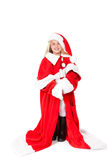 Little girl in a oversized santa costume Stock Photo